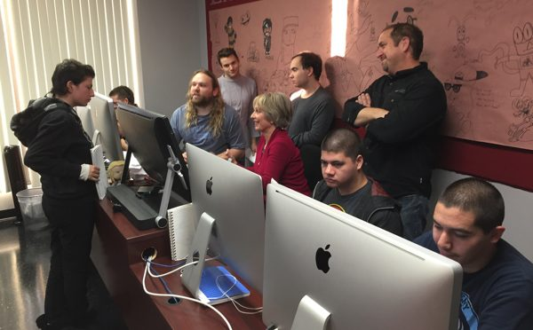 Dr. Ricki Robinson, Center, Brainstorms With Students At Exceptional Minds Vocational School For Young Adults With Autism On A New Interactive Webcast Series To Help Parents Interact With Children On The Autism Spectrum.